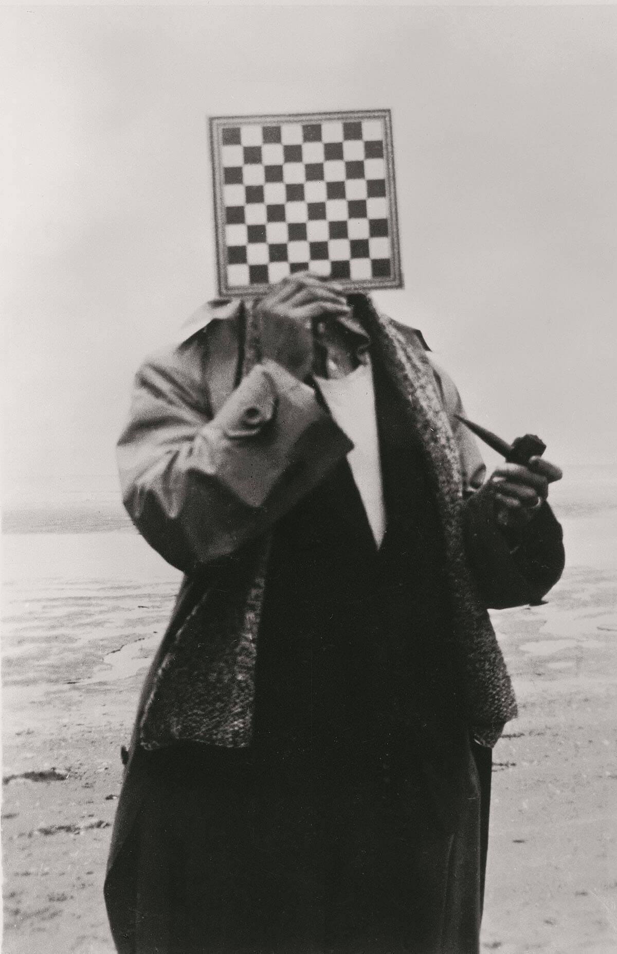 René Magritte portrait of a man with pipe and chess board