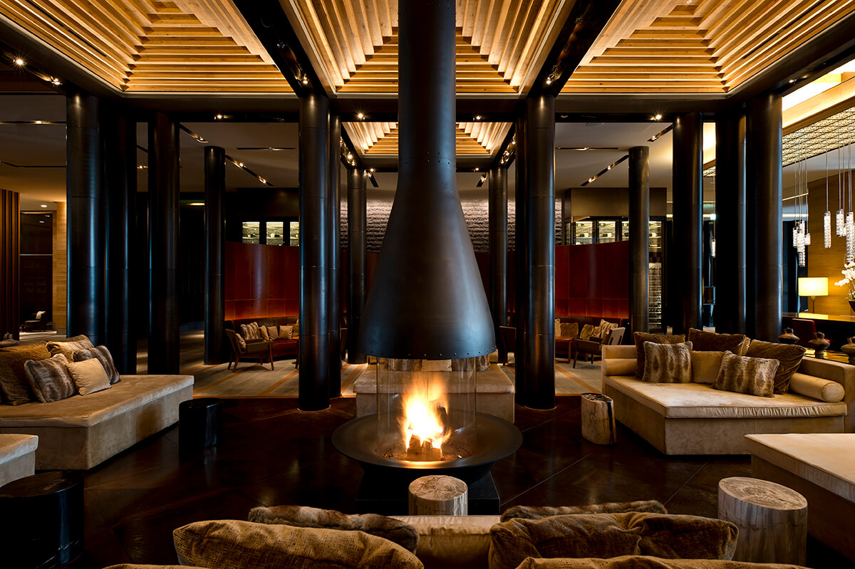 luxurious interiors of the Chedi Andermatt in Switzerland, designed to resemble a traditional chalet with Asian influences