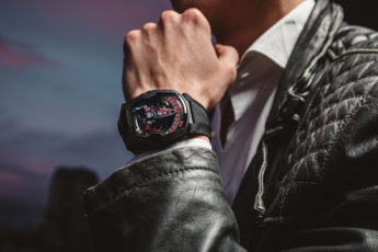 Luxury men's watch with black and red dial