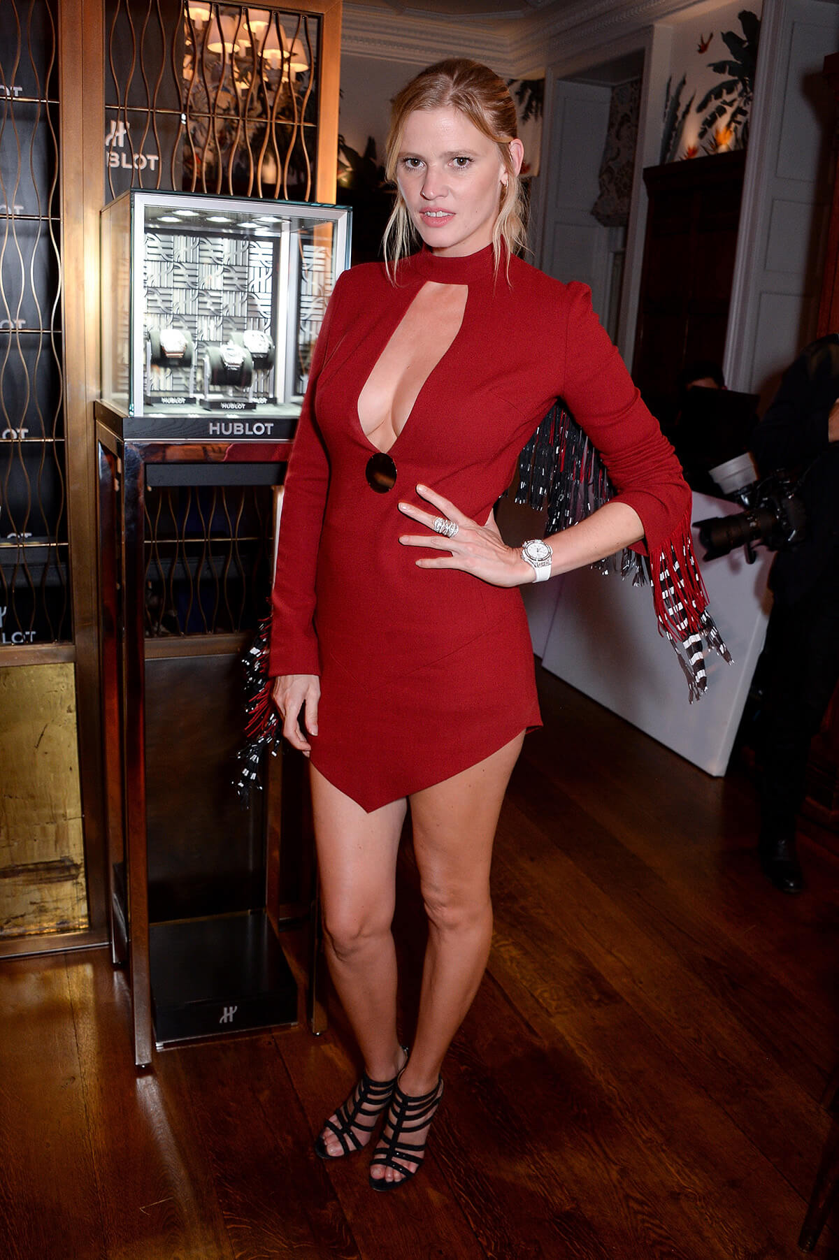 Model Lara Stone poses in short red dress