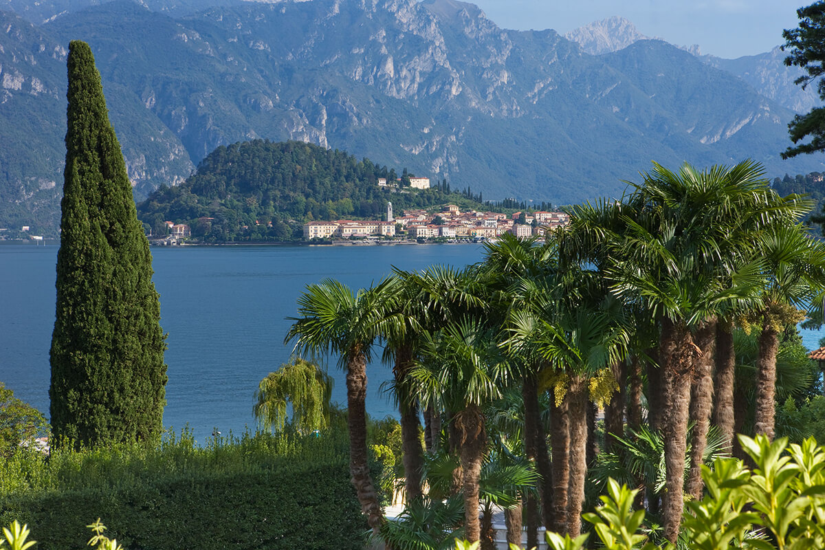 Landscape image of Lake Como in Italy with a pretty village on the lake's banks