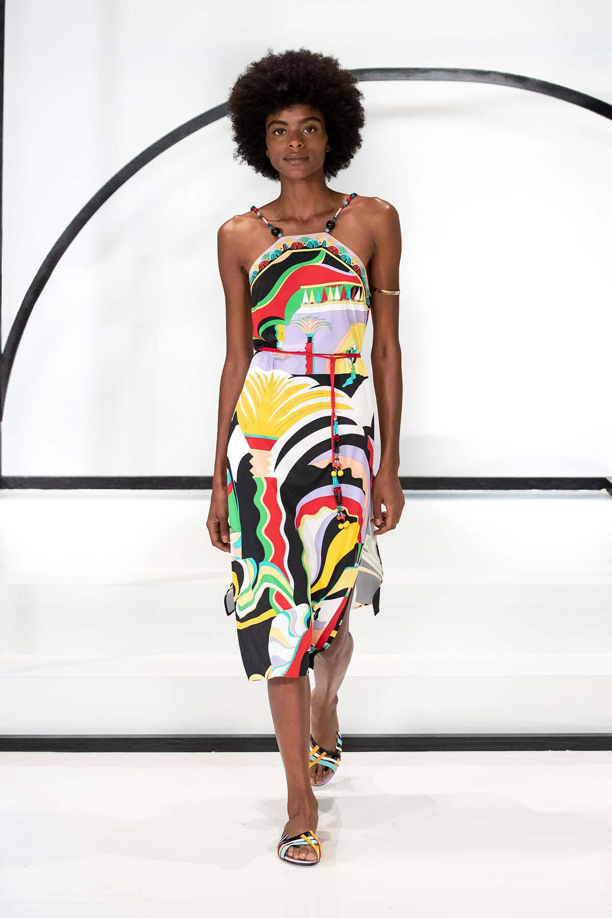 Model on catwalk wearing a colourful summer dress