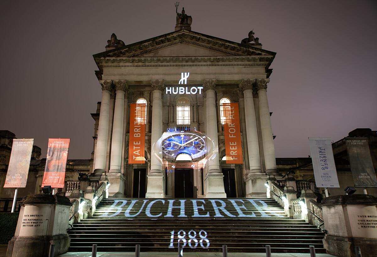 Hublot logo projected onto Tate Modern facade with Bucherer