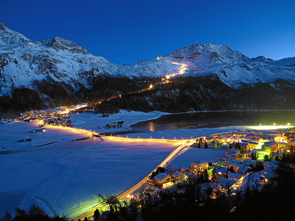 Ski slopes lit by lights at night in St. Mortiz