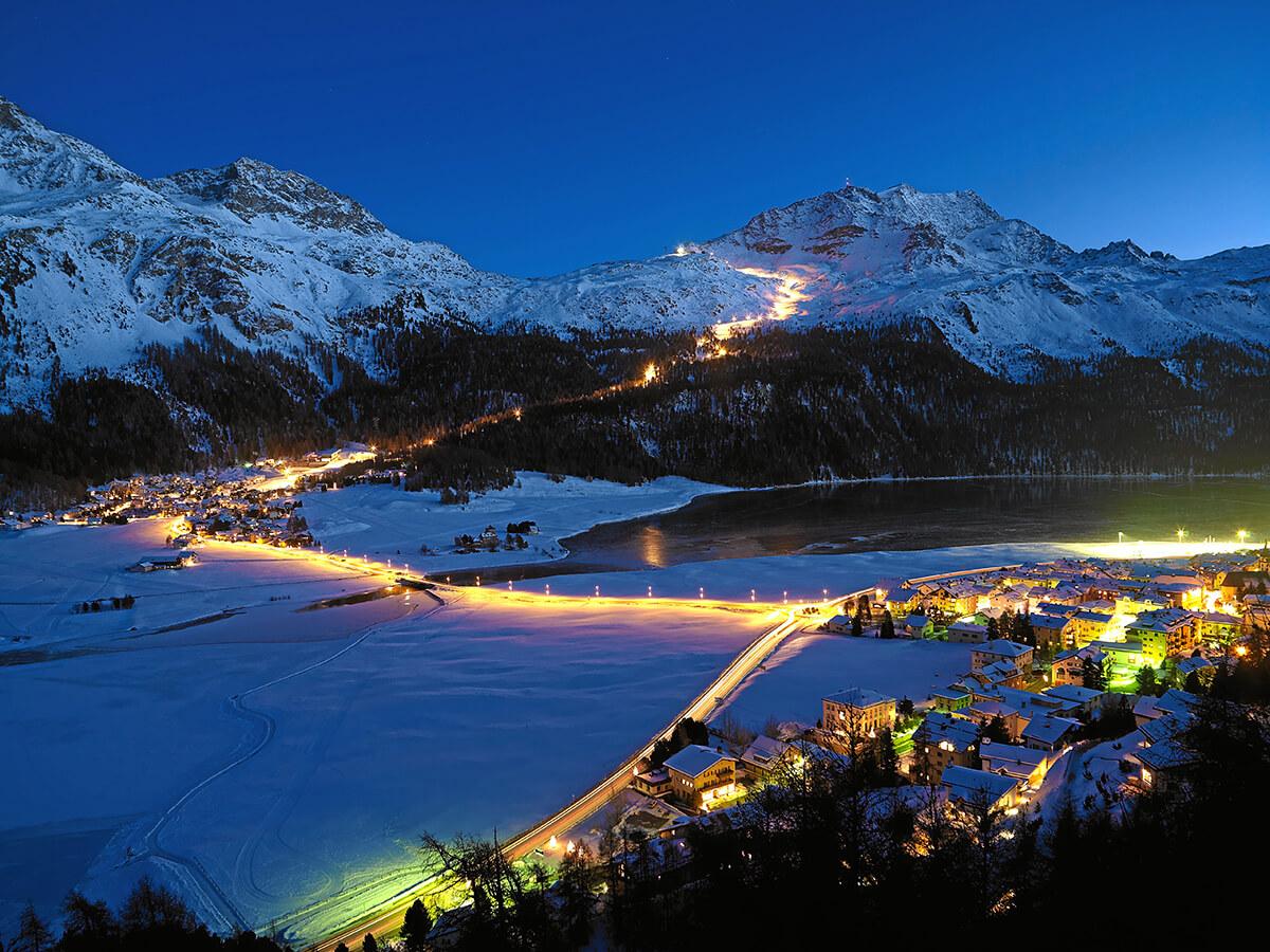 Ski slopes lit by lights at night in St. Mortiz