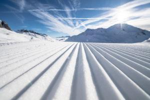 Close up shot of snow on a ski run