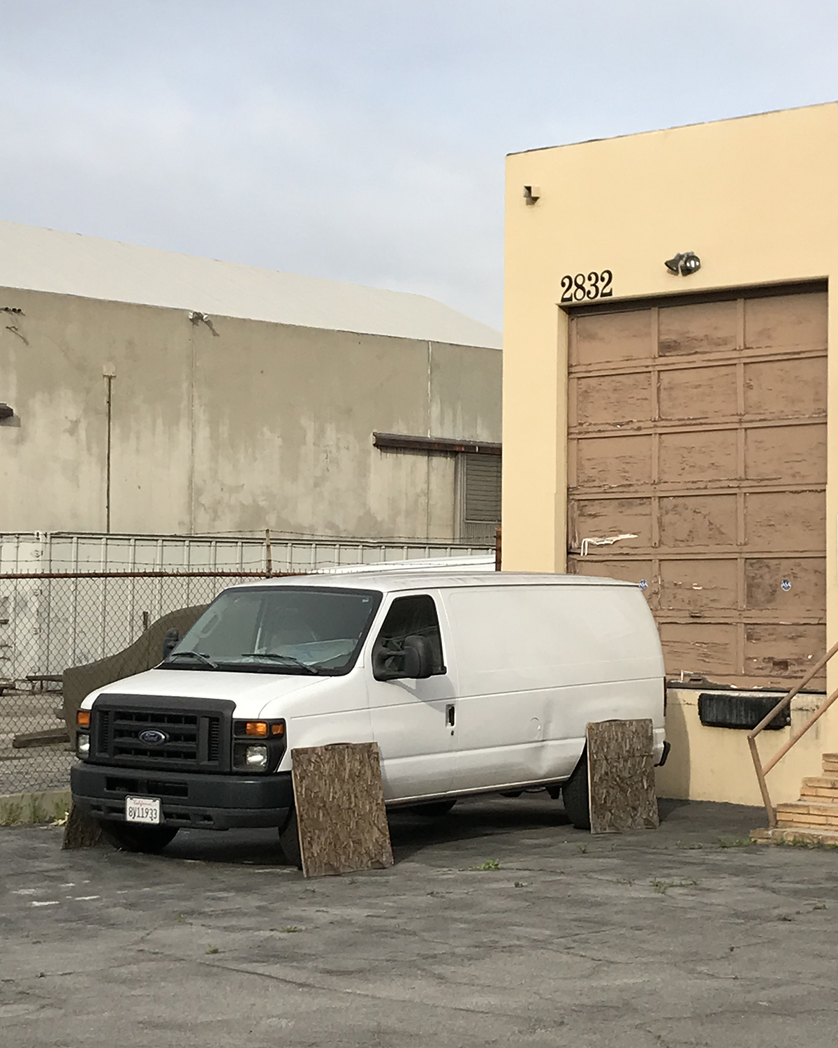 Surreal photograph of a white van without wheels