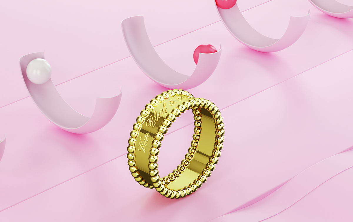 A gold ring on a pink surface with half pink circles in the background