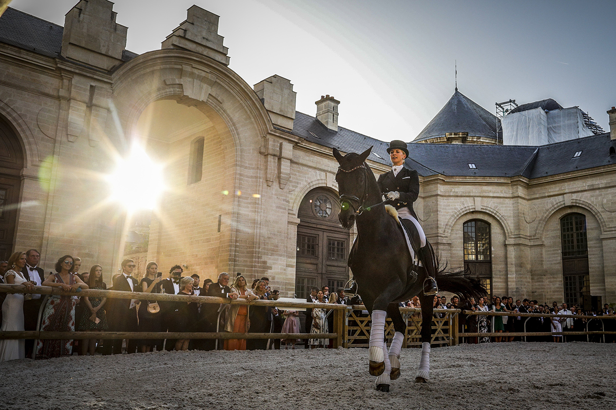 Horse rider performing in an arena of a stately home
