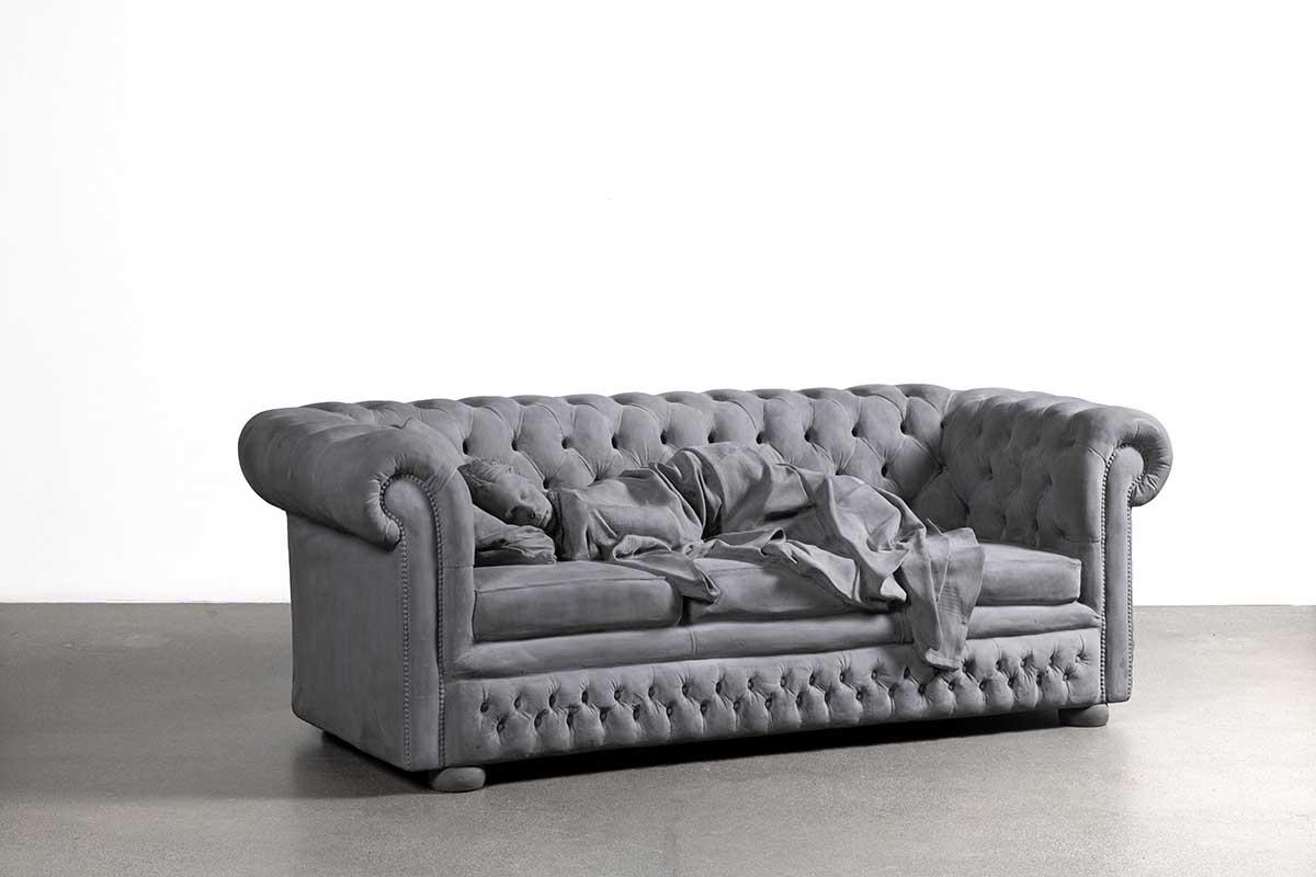 Sculpture of a girl asleep on a sofa