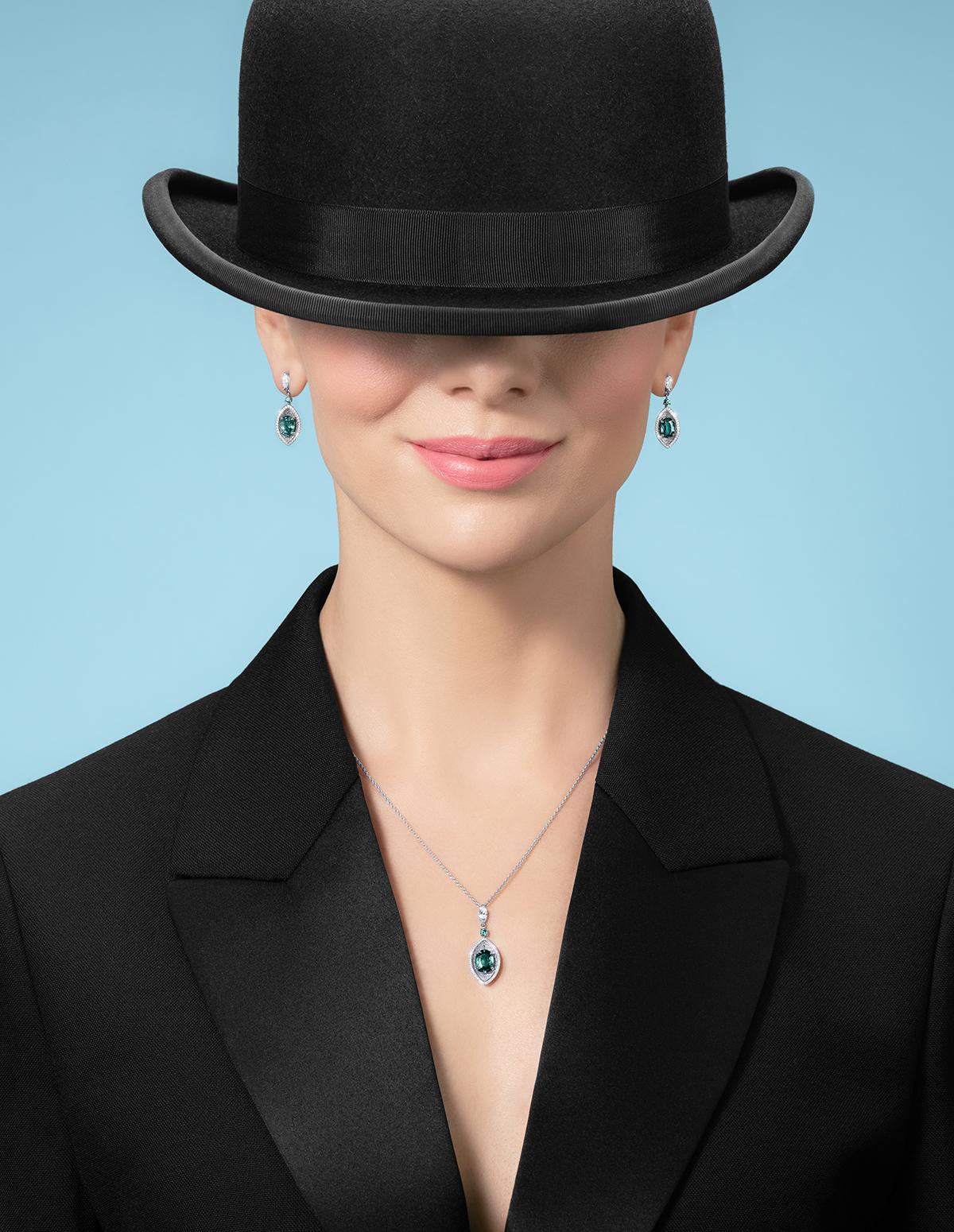 Woman wearing a bowling hat wearing jewellery