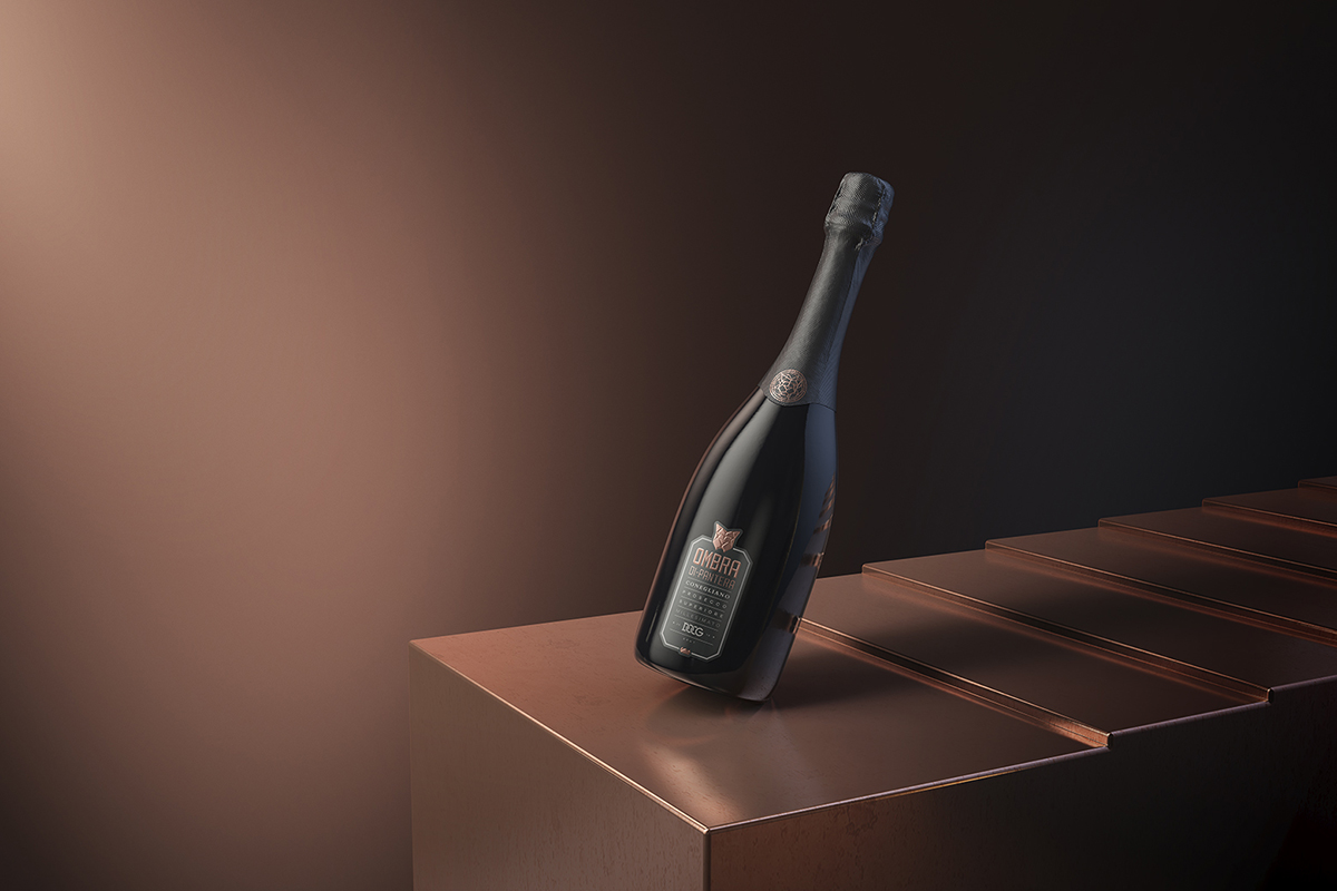 Prosecco bottle against brown background