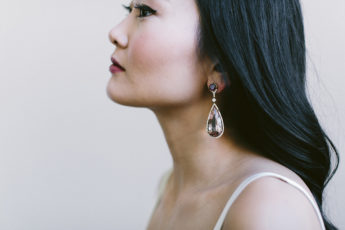 Model wearing drop earrings